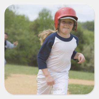 Girl in batting helmet running bases square sticker