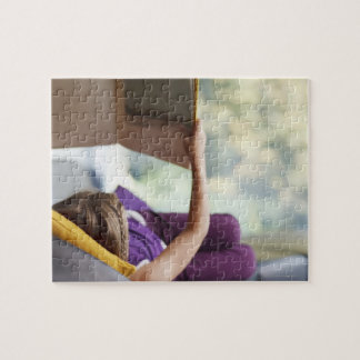 Girl laying down reading book jigsaw puzzle
