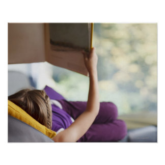 Girl laying down reading book poster