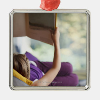 Girl laying down reading book Silver-Colored square decoration