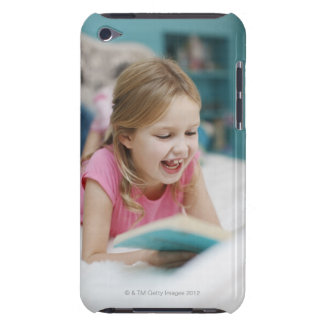 Girl laying in bed reading book iPod touch covers