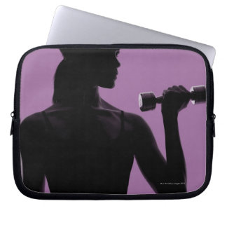 girl lifting dumbbell on purple background laptop computer sleeves
