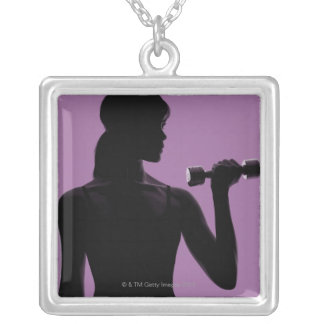 girl lifting dumbbell on purple background square pendant necklace