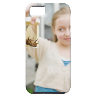 Girl looking at insect in jar in classroom case for the iPhone 5