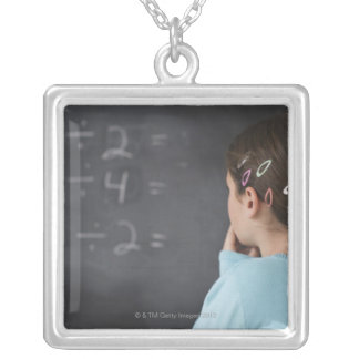 Girl looking at math equations on blackboard silver plated necklace