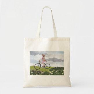 Girl on bicycle tote bag