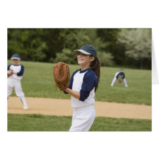 Girl pitching in little league softball game card