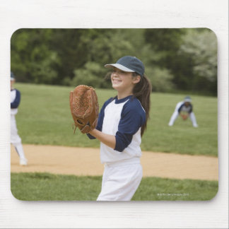 Girl pitching in little league softball game mouse pad