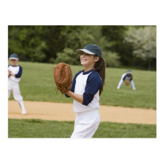 Girl pitching in little league softball game postcard