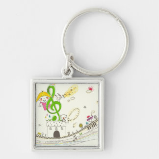 Girl playing with musical notes on house key ring