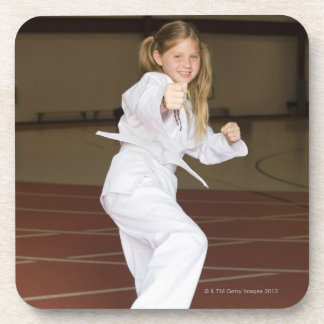 Girl practicing karate coaster