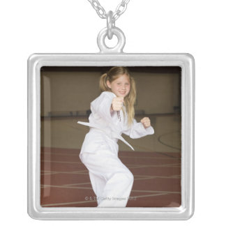 Girl practicing karate necklaces