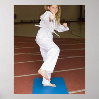 Girl practicing karate poster