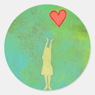 Girl reaching or letting go heart whimsical art round sticker