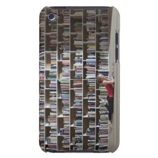 Girl reading by bookshelves barely there iPod case
