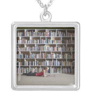 Girl reading by bookshelves silver plated necklace