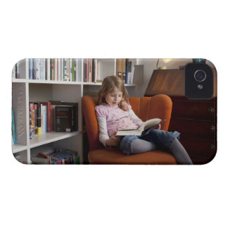 Girl reading by the bookshelf iPhone 4 cover
