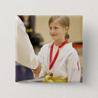 Girl receiving a medal at a Karate championship 15 Cm Square Badge