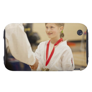Girl receiving a medal at a Karate championship iPhone 3 Tough Cover