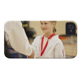 Girl receiving a medal at a Karate championship iPhone 4 Covers