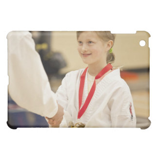 Girl receiving a medal at a Karate championship Cover For The iPad Mini
