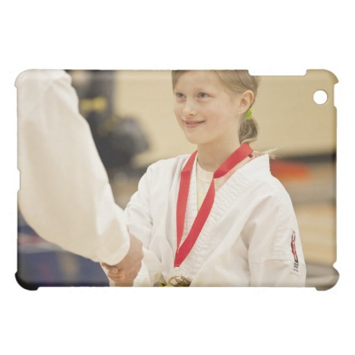 Girl receiving a medal at a Karate championship iPad Mini Case