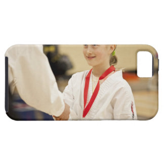 Girl receiving a medal at a Karate championship iPhone 5 Case