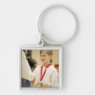 Girl receiving a medal at a Karate championship Key Ring