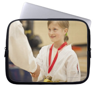 Girl receiving a medal at a Karate championship Laptop Computer Sleeves