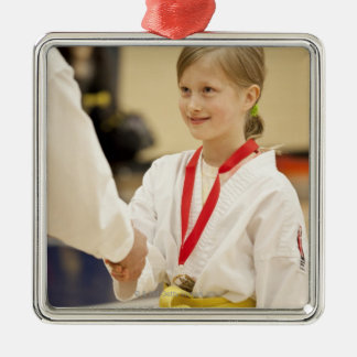 Girl receiving a medal at a Karate championship Silver-Colored Square Decoration