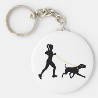 Girl running with her dog key chain