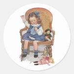 Girl Sewing Dollies Round Sticker