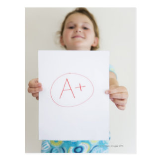 Girl showing off A+ grade on paper Postcard