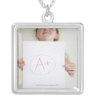 Girl showing off A+ grade on paper Square Pendant Necklace