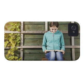 Girl sitting and reading book near vine iPhone 4 Case-Mate cases