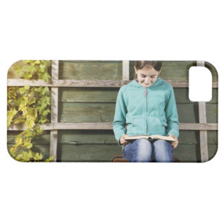 Girl sitting and reading book near vine iPhone 5 cases