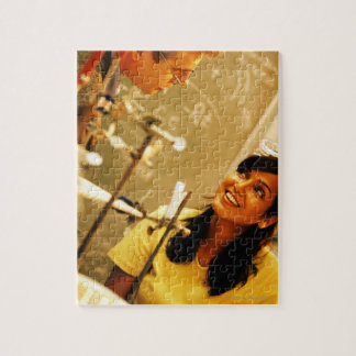 Girl smiling at teacher in chemistry lab puzzles