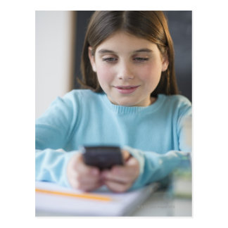 Girl texting in classroom postcard