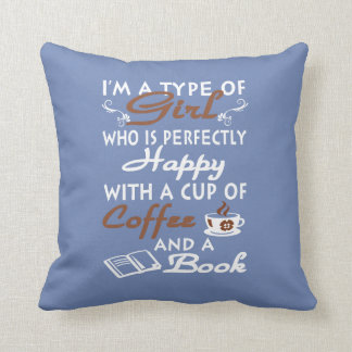 Girl with a cup of coffee and a book cushion