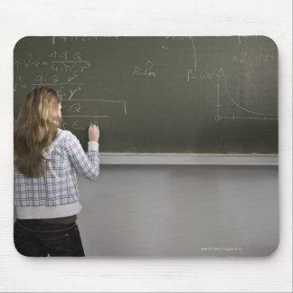 Girl writing on blackboard mouse pads