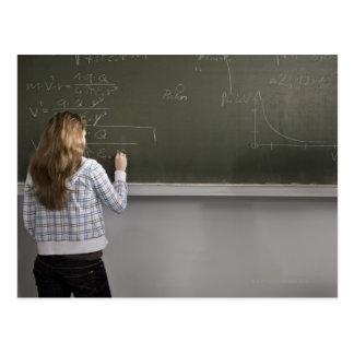 Girl writing on blackboard postcard