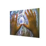 Girls hands on a plasma ball canvas print