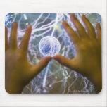 Girls hands on a plasma ball mouse mat