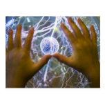 Girls hands on a plasma ball postcard