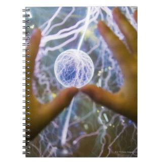 Girls hands on a plasma ball spiral notebook