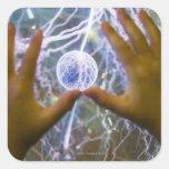 Girls hands on a plasma ball square sticker