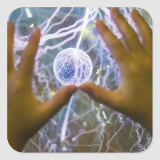 Girls hands on a plasma ball square sticker
