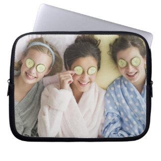 Girls having a facial laptop sleeve