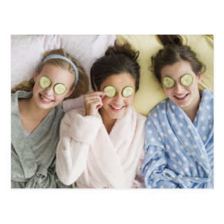 Girls having a facial postcard