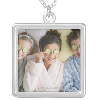 Girls having a facial silver plated necklace